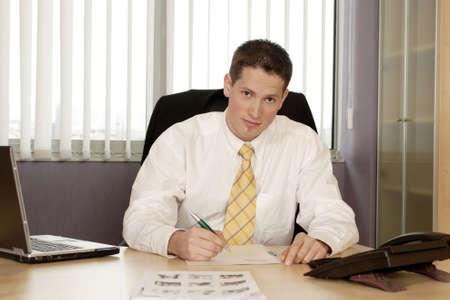 Businessman signing document. Stock Photo - 3191572