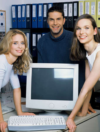 Corporate people smiling at the camera. Stock Photo - 3191577