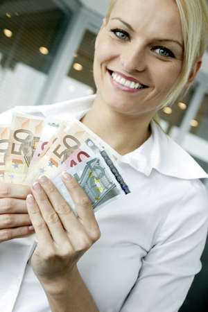 Businesswoman holding bank notes. Stock Photo - 3191596