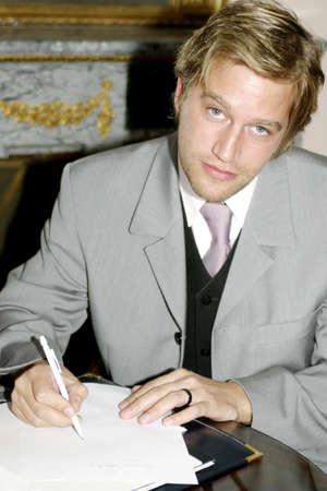 Businessman writing report. Stock Photo - 3191600