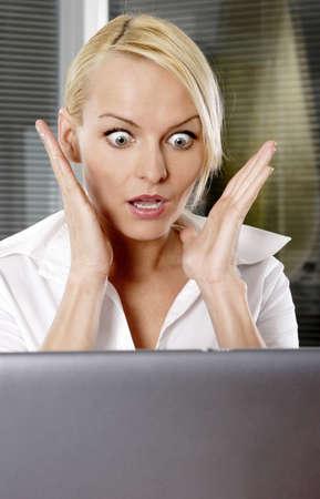 terrified woman: Businesswoman in shock.