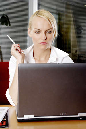Businesswoman working on her laptop. Stock Photo - 3191612