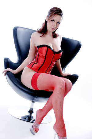 Woman in black and red corset sitting on chair Stock Photo - 3191737