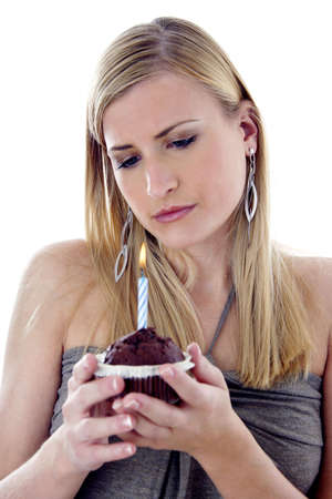 Woman looking sadly at her birthday cake Stock Photo - 3191788