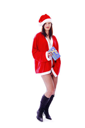 Sexy woman in santa suit, holding a present Stock Photo - 3191938