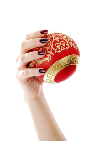 nails: Hand holding a Christmas ball ornament