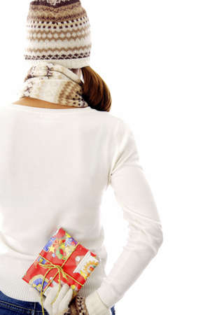 Woman holding a gift behind her back Stock Photo - 3191986