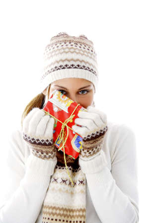 winter woman: Woman in winter clothing holding a gift
