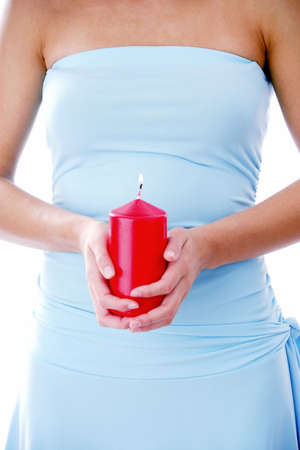 Woman holding a lit red candle Stock Photo - 3191994
