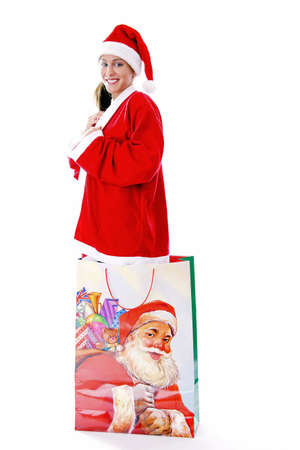 Sexy woman in santa suit, standing in a big shopping bag Stock Photo - 3191997