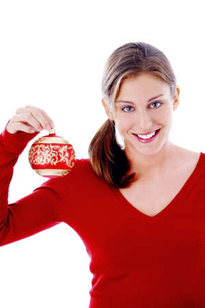 Woman holding a Christmas ball ornament LANG_EVOIMAGES