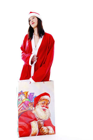 Sexy woman in santa suit,standing in a big shopping bag LANG_EVOIMAGES