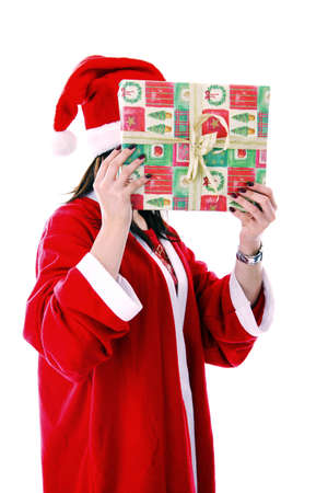 Woman in santa suit covering face with a gift Stock Photo - 3192010