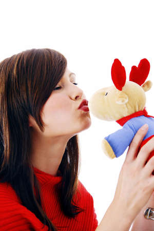 soft toy: Woman kissing soft toy LANG_EVOIMAGES