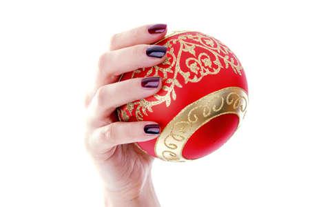 Hand holding a Christmas ball ornament Stock Photo - 3192014