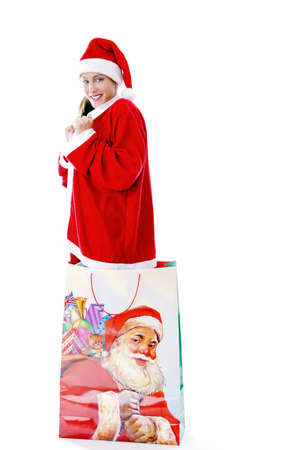 Sexy woman in santa suit, standing in a big shopping bag Stock Photo - 3192015
