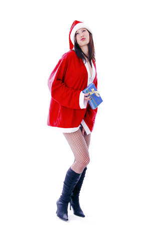 Sexy woman in santa suit, holding a present Stock Photo - 3192019