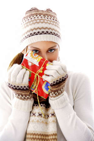 Woman in winter clothing holding a gift Stock Photo - 3192024