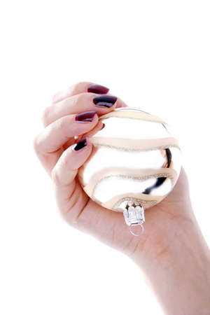 Hand holding a Christmas ball ornament