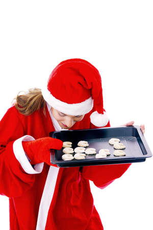 Woman smelling freshly baked cookies in a tray Stock Photo - 3192026