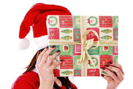 Woman in santa suit covering face with a gift Stock Photo - 3192028