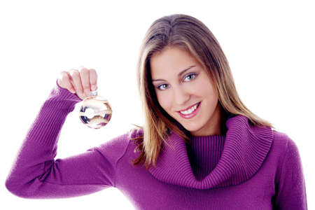 Woman holding a Christmas ball ornament Stock Photo - 3192030
