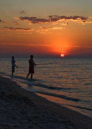 Fishing at dawn Stock Photo