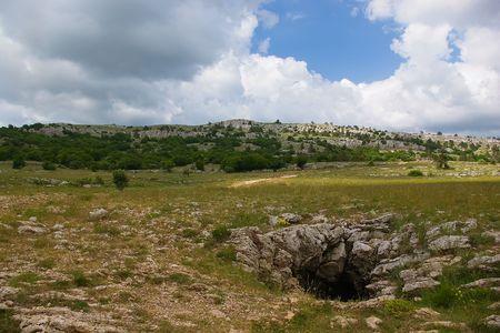 Cave on Ai-Petri plateau. Stock Photo - 7808849
