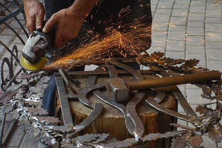 Grinding forged products.
