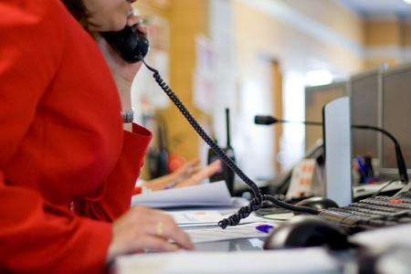 Call center in an office, a woman answering a call Stock Photo