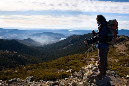 Mountaineer watching nearby peaks Stock Photo