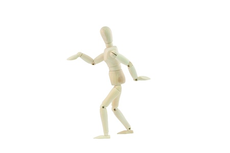 Articulated wooden dummy dancing isolated on white background Stock Photo