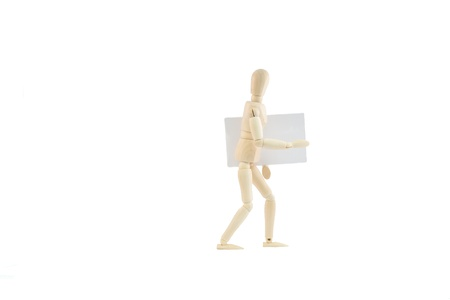 articulated wooden dummy showing a business card, isolated on white background