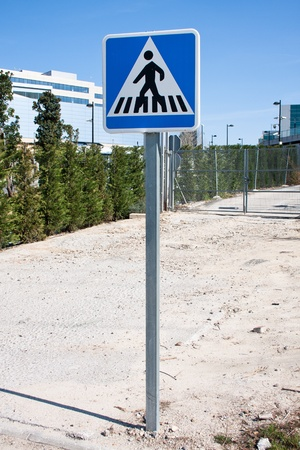 road sign to warn drivers of a pedestrian crossing next Stock Photo