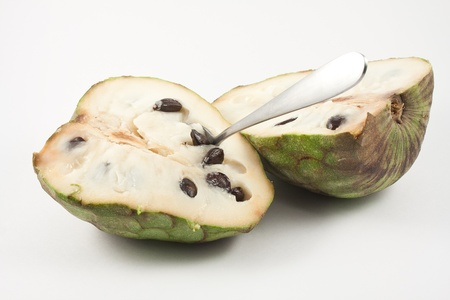 chirimoya: chirimoya halved isolated on white background Stock Photo