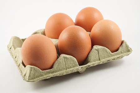 egg carton with eggs isolated on white background photo