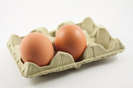 egg carton with eggs isolated on white background