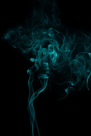 abstract forms created with blue smoke isolated background