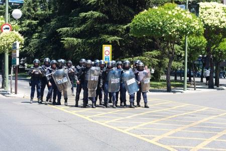 riot policemen against protesters prepared in a strike in Madrid