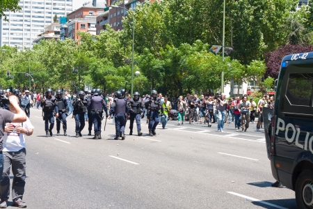 riot: riot policemen against protesters prepared in a strike in Madrid