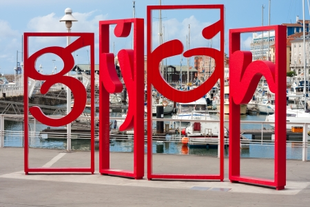 Monument at the port of Gijon, which displays letters of gijon