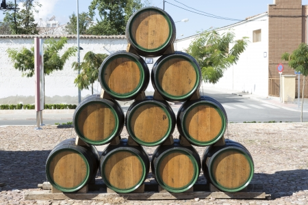 casks: wooden barrels for wine, placed in a pyramid