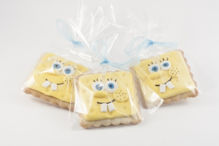 three decorated cookies in the shape of sponge bob