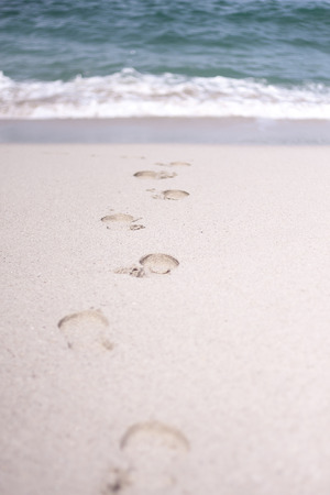 Traces of people in the sand of a beach