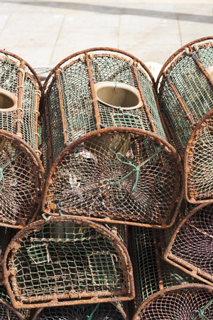 traps: lobster traps stacked in the fishing port Stock Photo