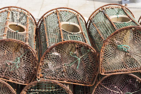 lobster pots: lobster traps stacked in the fishing port Stock Photo