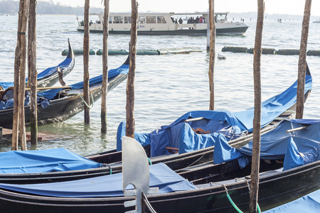gondolas moored in the canals of Venice Stock Photo