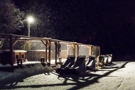 kiruna: Six sled on white snow in the night in Kiruna Sweden