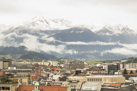 Innsbruck with snow covered mountains in the background Stock Photo