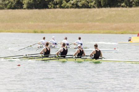 summer olympics: Rowers in rowing boats on the tranquil lake Editorial